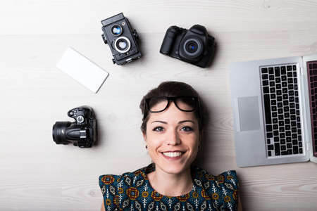 happy creative woman is a web designer or a photo editor