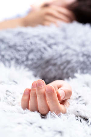 person sleeping immersed in furry pillows and blanket