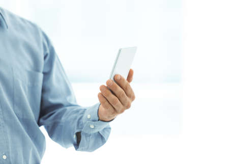 Business man holding mobile phone. Stock Photo