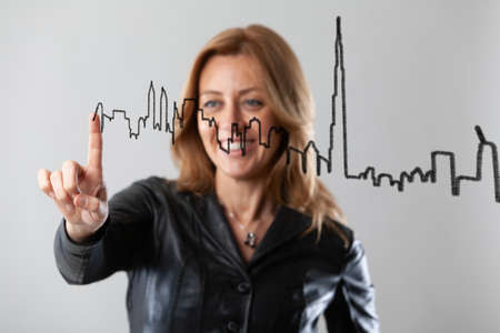 cheering architect drawing a skyline ni the air figuring out the future of a city