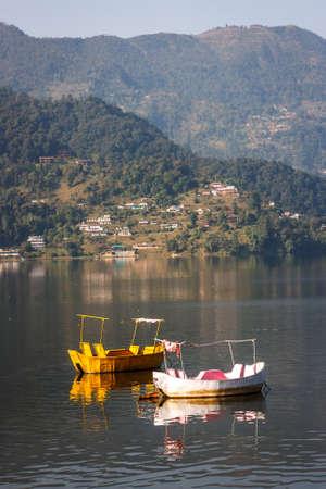 phewa: Small wooden colored boats on the Phewa Lake, Pokhara, Nepal
