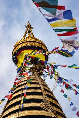 The golden stupa of the Swayambunath Temple with flags, Kathmandu, Nepal Stock Photo