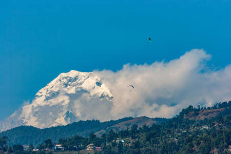 phewa: Paragliders over the Hiunchuli viewed from Pokhara, Nepal