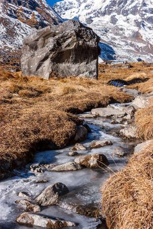 Frozen stream in the morning on the Annapurna Base Camp Trek, Nepal Stock Photo