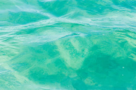 Detail of a green blue water, a wave in the lagoon,  at the Laguna Bacalar, Chetumal, Quintana Roo, Mexico.