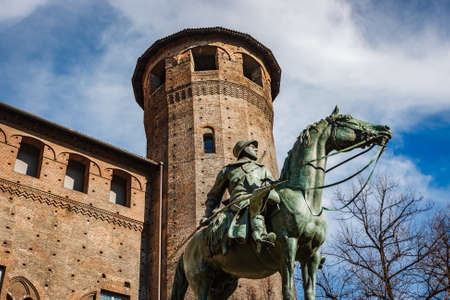 loophole: Bronze statue in front of a tower of Madama Palace, Turin, Italy