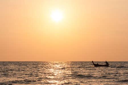 Scenic view of a traditional thai long tail boat at sunset, Long Beach, Ko Lanta, Thailand.