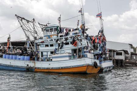 Fishing boats harbored in Krabi, Thailand Stock Photo