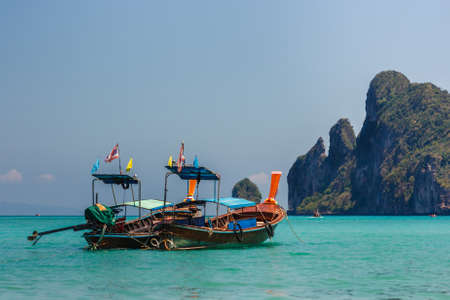 Scenic view of two traditional thai longtail boats in Loh Dalam Bay, Phi Phi Island, Thailand.