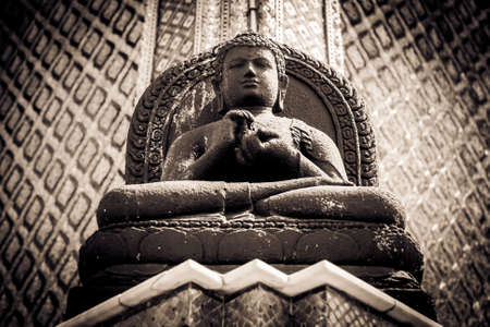 Black and white picture of the Stone Buddha statue at the Wat Phra Kaew Palace, also known as the Emerald Buddha Temple. Bangkok, Thailand.