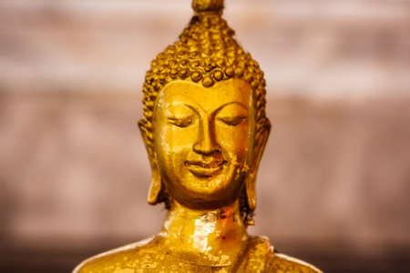 Portrait of a golden Buddha statue at Wat Intharawihan Temple, Bangkok, Thailand Stock Photo