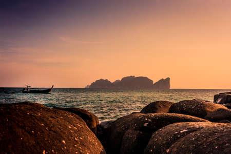 Scenic view of traditional thai long boat in front of Phi Phi Leh at sunset, Phi Phi Island (Koh Phi Phi), Thailand.