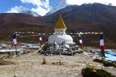 View of an ancient stupa in Dingboche, with prayer flags, Everest Base Camp trek, Nepal