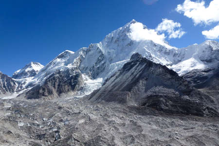 Scenic view of Mount Lhotse and Khumbu glacier, seen from Gorak Shep, with blue sky and big clouds, Everest Base Camp trek, Nepal