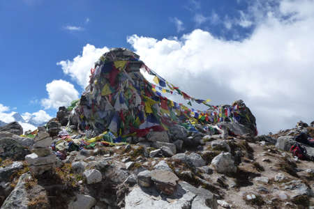 View of many prayer flags on the top of the Thokla pass, Everest Base Camp trek, Nepal Stock Photo