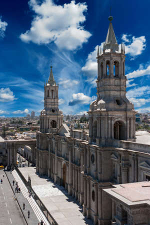 Picture of the Arequipa catherdral, Peru over a big blue sky with clouds