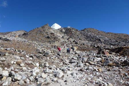 A group of trekkers over a difficult pass near Gorak Shep, Everest Base Camp trek, Nepal