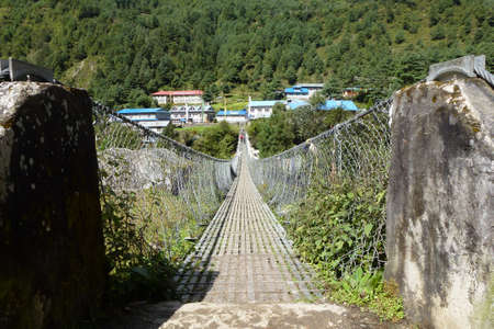 Suspension bridge over a river in Phakding, Everest Base Camp trek, Nepal Reklamní fotografie