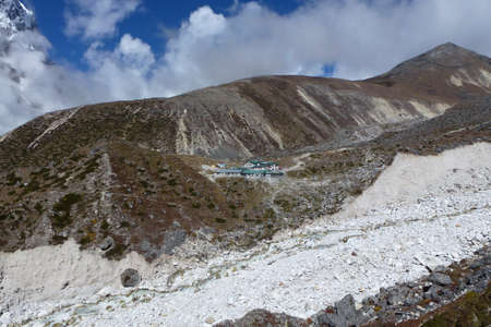 View of Thokla (Thok La) lodges with blue sky and clouds, Everest Base Camp trek, Nepal Stock Photo