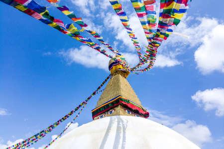 Scenic view of the dome of the Boudhanath Stupa, with prayer flags, Kathmandu, Nepal Reklamní fotografie