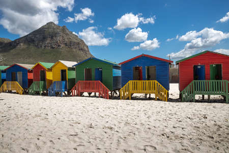 Picture of the colored cabins in Muizenberg beach near Cape Town, South africa, known for its wooden houses painted in vibrant colors Stock Photo