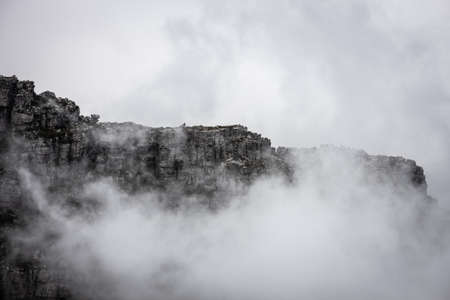 Scenic view of the clouds rolling over Table Mountain in Cape Town, Southafica. This fenomenon is called Tablecloth.