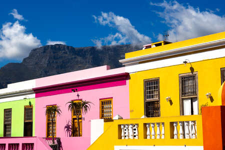 PIcture of the colored houses in Bo Kapp, a district of Cape Town, South africa known for it's houses painted in vibrant colors Stock Photo