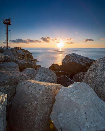 Two Fishermen in Riccione port on the Adriatic sea at sunrise in summer 版權商用圖片