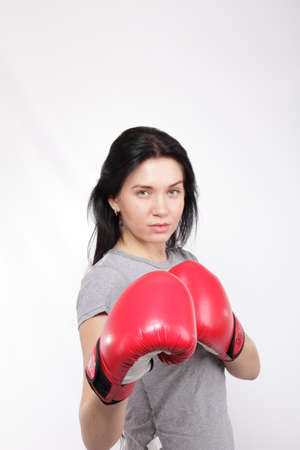beautiful young woman wearing a pair of boxing gloves  photo