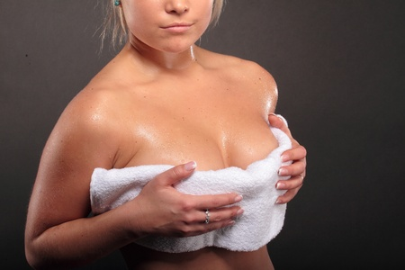young blonde woman after bath with towel  photo