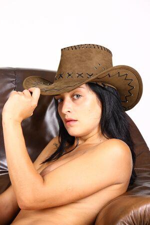 Young cow girl on sofa Stock Photo