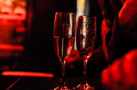 Champagne flutes in a night club during party Stock Photo