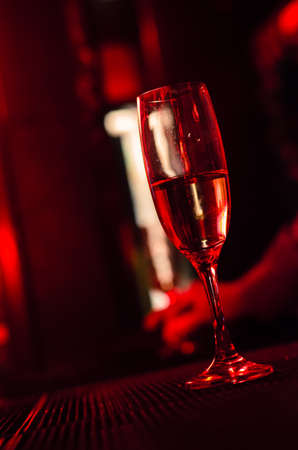 Champagne flute in a night club during party
