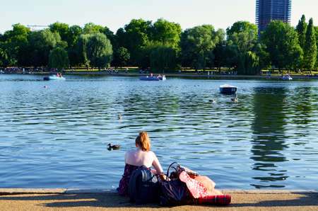 red hair girl looking the lake photo