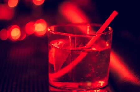 Tumbler glass in night club