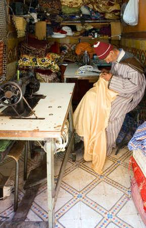 tailor shop: Marrakech, Morocco - March 24, 2006: A tailor shop in the market of the Medina quarter Editorial