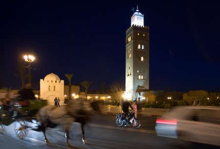 twelfth night: Marrakech, Morocco - March 23, 2006: Night view of the minaret of the Koutoubia great mosque, the twelfth century Editorial