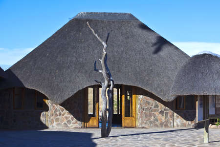 wag: Palm wag, Namibia - December 7, 2009: Typical architecture of a lodge