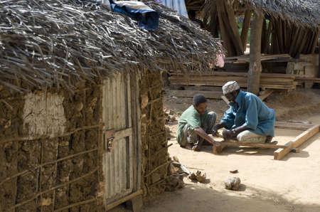 local 27: Zanzibar, Tanzania - February 27, 2008:  Local people working the wood in an inland village