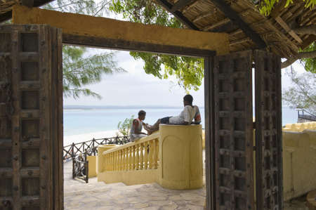 local 27: Zanzibar, Tanzania - February 27, 2008:  Western coast, local people relaxing at the entrance of a resort of  Prison island