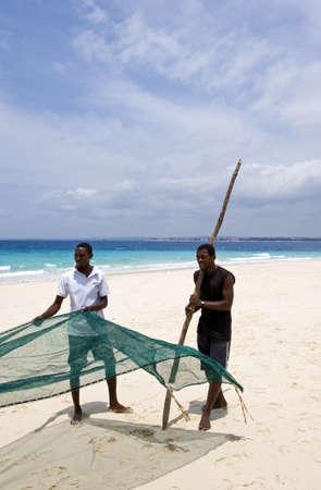 local 27: Zanzibar, Tanzania - February 27, 2008:  Western coast, local  people working on a beach of Prison island