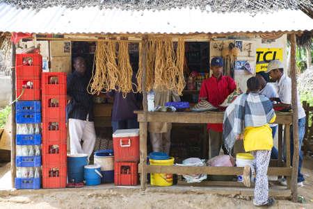 local 27: Zanzibar, Tanzania - February 27, 2008:  Local people in a shop of drinks in an inland village