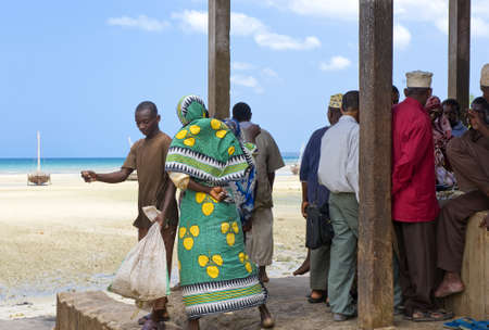 local 27: Zanzibar, Tanzania - February 27, 2008:  Western coast,  local people in a market near the beach