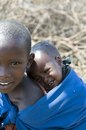 babysitting: Ngorongoro, Tanzania - August 25, 2008:  Maori cildrens in a village of the National Park