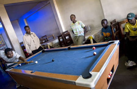 playing the market: Aruscha, Tanzania - September 2, 2008: Young local people playing in a tavern of the general market Editorial