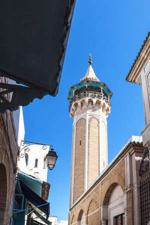 minaret: Tunisia, Tunis, the Sidi Youssef mosques octagonal shaped minaret Stock Photo