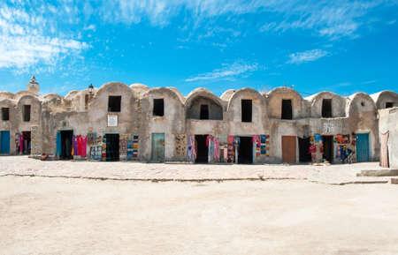 april 15: Medenin, Tunisia - April 15, 2008: Craft shops in the Ksar , ancient fortified berber granary Editorial