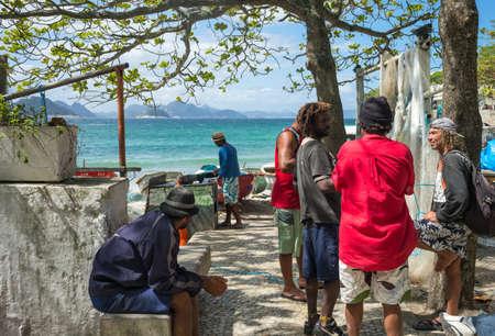 Rio De Janeiro, Brazil  - September 6, 2013: Local fishermen in the Colonia De Pescadores in Copacabana beach