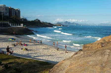 promontory: Rio De Janeiro, Brazil  - September 9, 2013: People in  the Praia do Diabo seen from the Pedra do Arpoador promontory