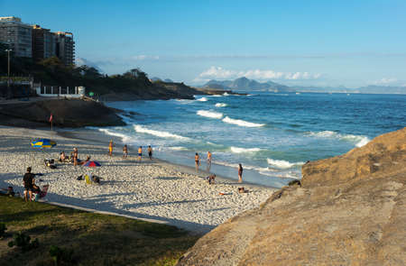 Rio De Janeiro, Brazil  - September 9, 2013: People in  the Praia do Diabo seen from the Pedra do Arpoador promontory